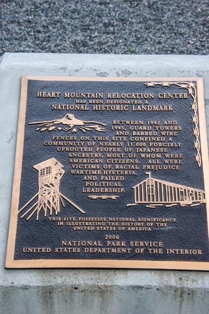 A memorial plaque at the Heart Mountain Relocation Center tells the story of the camp outside of Cody, Wyoming where,, between 1942 and 1945, nearly 11,000 Japanese-Americans were held. At the time, the size of the population housed there made Heart Mountain the third-largest city in Wyoming.