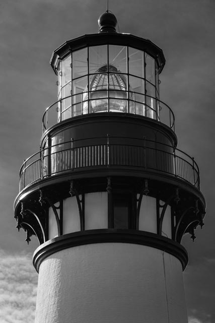 The light towner in Yaquina Head Lighthouse, built in 1872, tops out at 93 feet. The lighthouse is built on a narrow promontory of land sitting nearly a mile out into the Pacific Ocean. It is Oregon's tallest lighthouse. The oil-burning lamp has been replaced with a 1000-watt globe but the lighthouse still shines its light every night to alert mariners to this hazardous stretch of coastline,