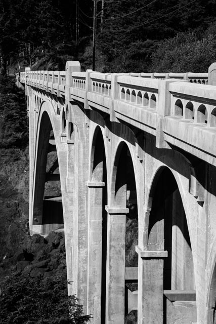 Rocky Creek bridge, also known as the Ben Jones bridge, was built in 1927 and stands at the southern end of Otter Crest Loop. The bridge spans Rocky Creek along the Pacific Ocean. The arch bridge was added to the National Register of Historic Places in 2005.