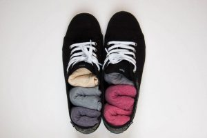 storing rolled socks in shoes