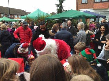 9-Children enjoy Santa's gifts
