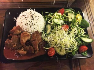 """Duck"" in plum and vine sauce with rice and salad"