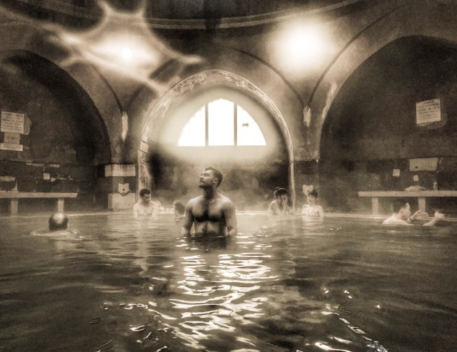 black and white image of people standing in a pool with kiraly thermal bath in