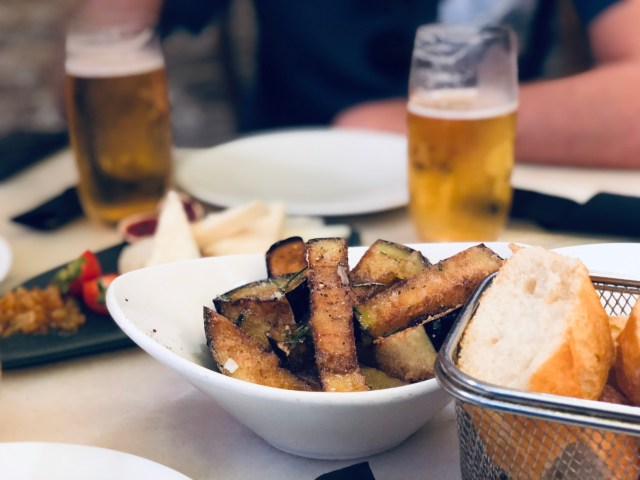 fried aubergines and beers at tapas bar in barcelona