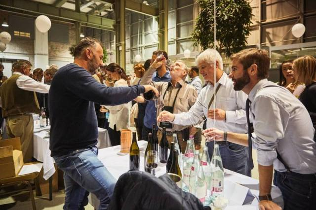 man pouring wine at a local wine festival