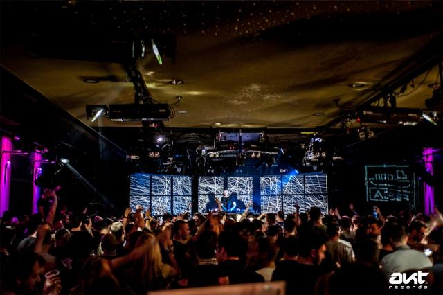 people-partying-at-nightclub-in-budapest-with-neon-lights-loud-music
