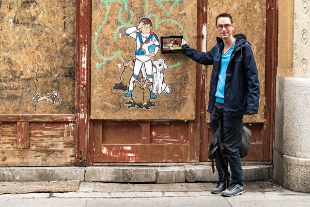 blue shirt brown wall jacket space man aliens budapest street art