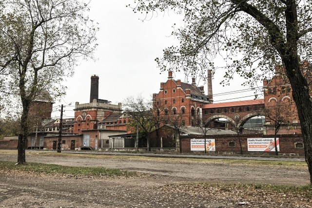 brick building trees factory old