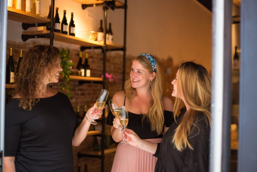 three-women-toasting-with-glasses-of-wine-in-barcelona-wine-bars