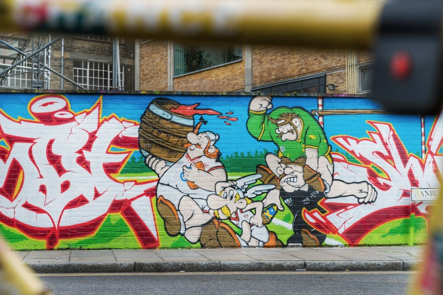 street art in brick lane showing cartoon figures of asterix oblix and Gaulish warriors