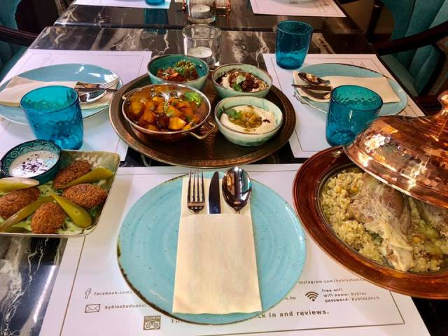 a mezze of lebanese dishes on a table at a restaurant in Budapest