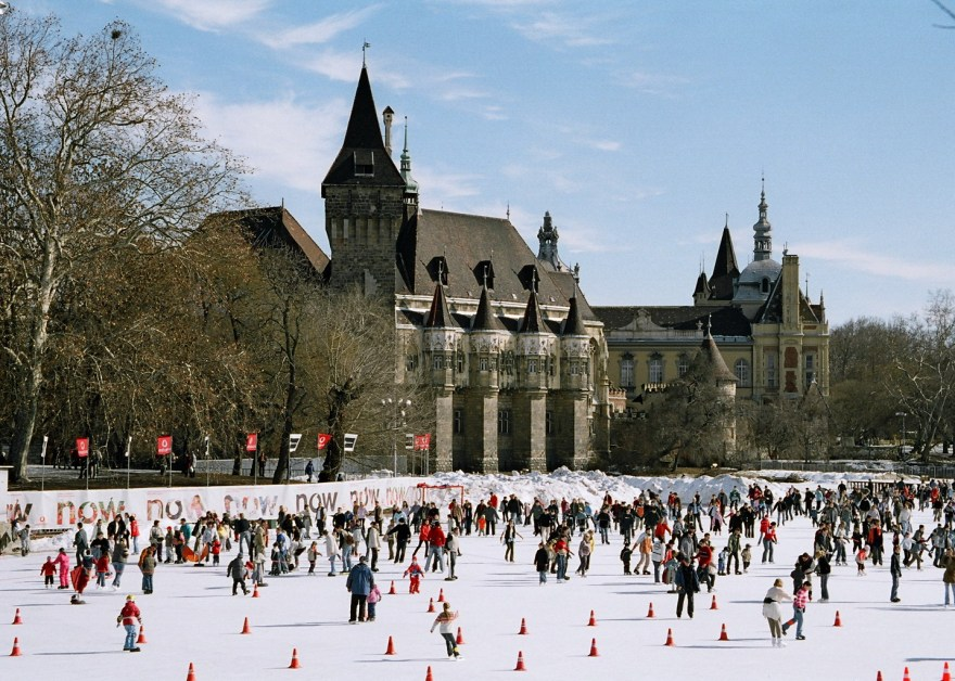 people-skating-on-outdoor-ice-rink-in-front-of-castle