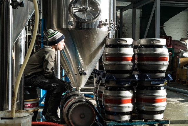 brewer contemplating kegs beer