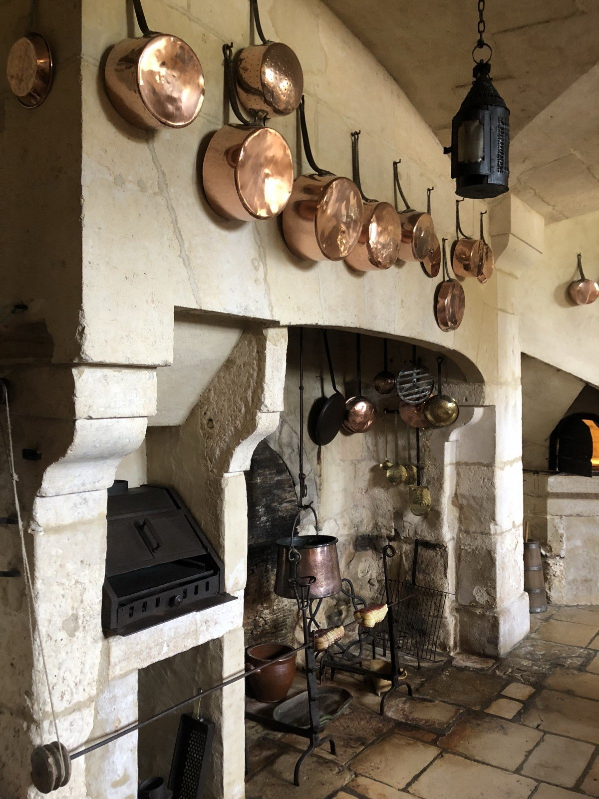 Chateau de Vendeuvre , copper pans in the kitchen