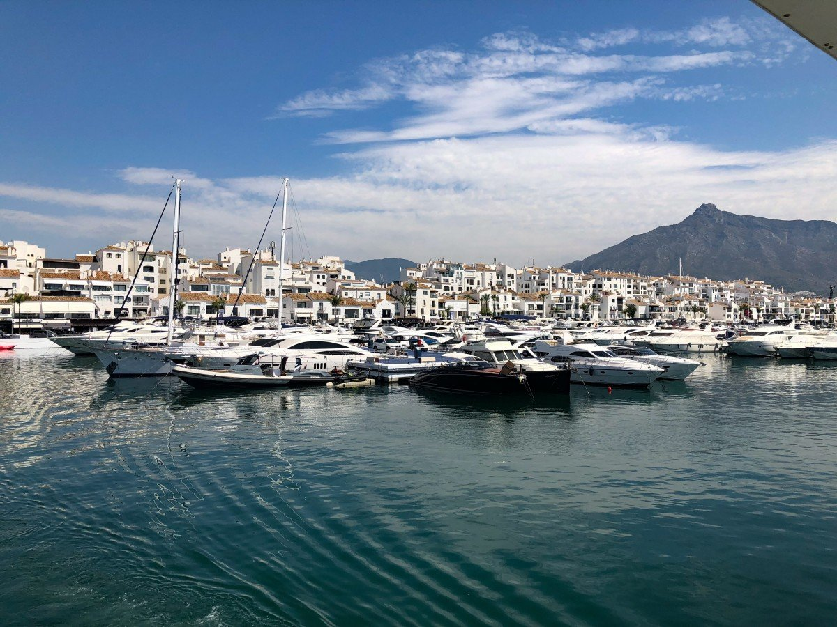 Puerto Banus to Marbella Boat Trip Fly Blue ferry view of Puerto Banus View of the hills