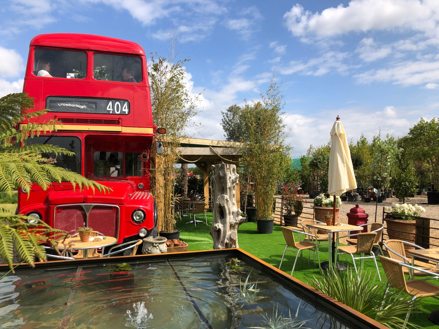There is plenty of seating on the bus inside upstairs and a fully equipped kitchen. The bus also has a stunning outside space in the sunshine surrounded by the gorgeous Essex countryside. Tables and chairs are laced with potted plants whilst horses graze in the distance.