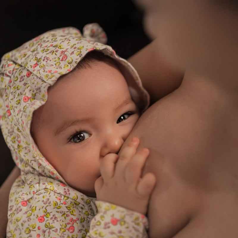 photo of baby breastfeeding