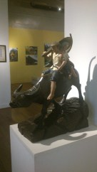 A wooden sculpture of a Filipino couple on a carabao