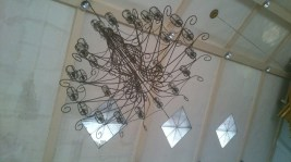 One of the few metal chandeliers of the church