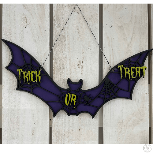 Trick or treat bat sign