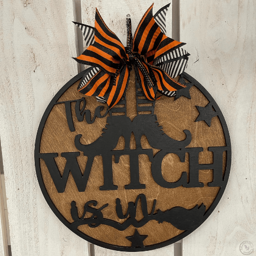The Witch Is In Round Sign