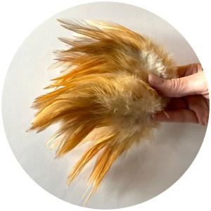 Strung Rooster Saddles Long – Nat. Ginger