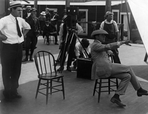 "D.W. Griffith directing a scene from ""Intolerance"""