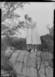Nell Dorr (1893-1988); [Lillian Gish and Nell Dorr embracing atop rock]; nitrate negative; Amon Carter Museum of American Art; Fort Worth TX; P1990.47.3473