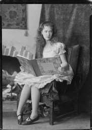 Nell Dorr (1893-1988); [Girl seated with book on lap]; nitrate negative; Amon Carter Museum of American Art; Fort Worth TX; P1990.47.3479