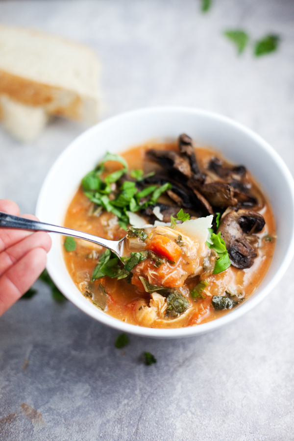 Instant Pot Creamy Tomato Chicken Soup in a bowl with mushrooms