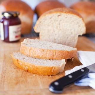 sliced loaf of homemade wheat bread