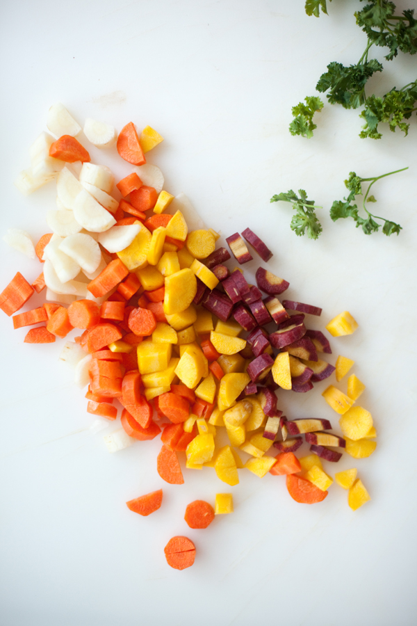 Cutting board of chopped rainbow carrots