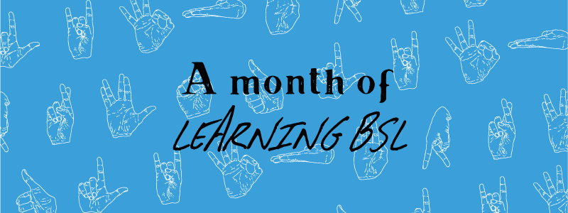 A month of learning BSL on blue background with hand gestures in the background