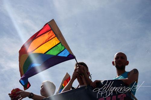 rainbow flag at brighton pride being waved