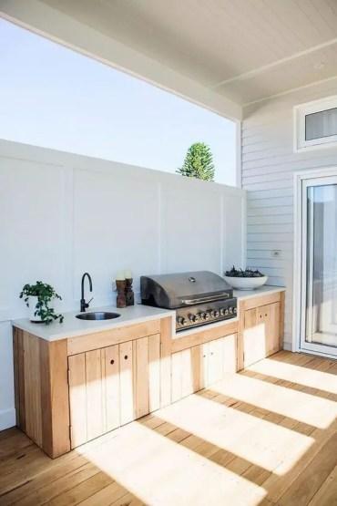 Comment bien aménager sa cuisine d'été en bois ?