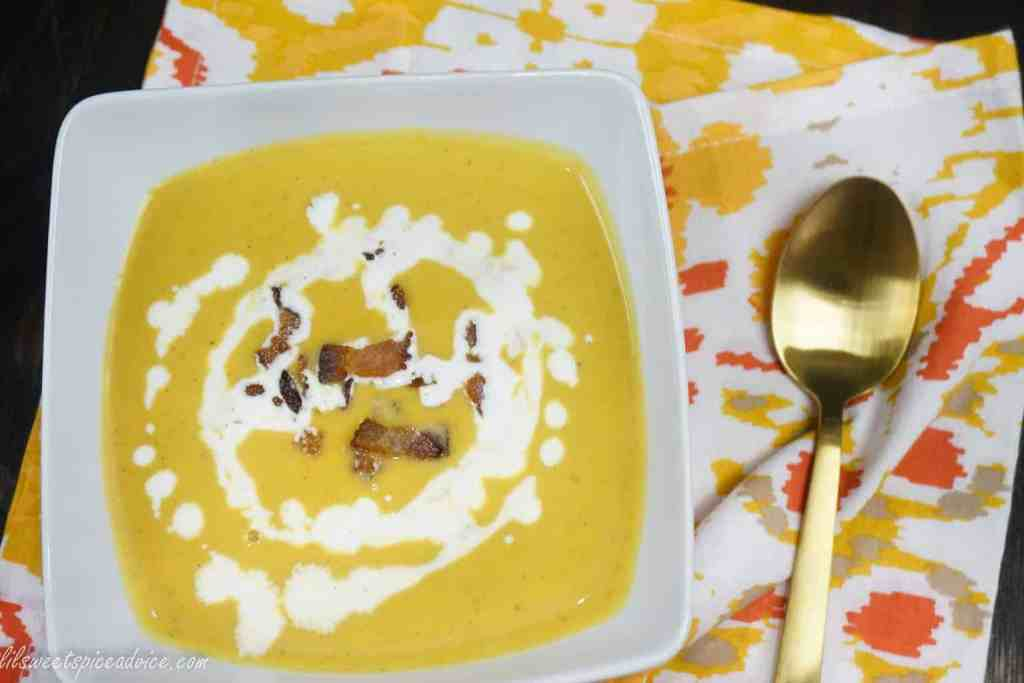 Roasted Pumpkin Soup -- Freshly roasted pie (sugar) pumpkin deserves some spotlight in a delightfully creamy soup topped with crispy bacon. -- lilsweetspiceadvice.com #roastedpumpkin #pumpkinsoup #creamysoup