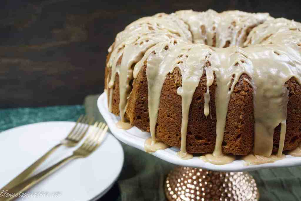 Sweet Potato Cinnamon Streusel Bundt Cake with Brown Sugar Bourbon Glaze-- This cake is sure to please your Thanksgiving and holiday guests with the flavors of fall and super moistness thanks to the mashed sweet potatoes. -- lilsweetspiceadvice.com #sweetpotatocake #bundtcake #holidaybundtcake