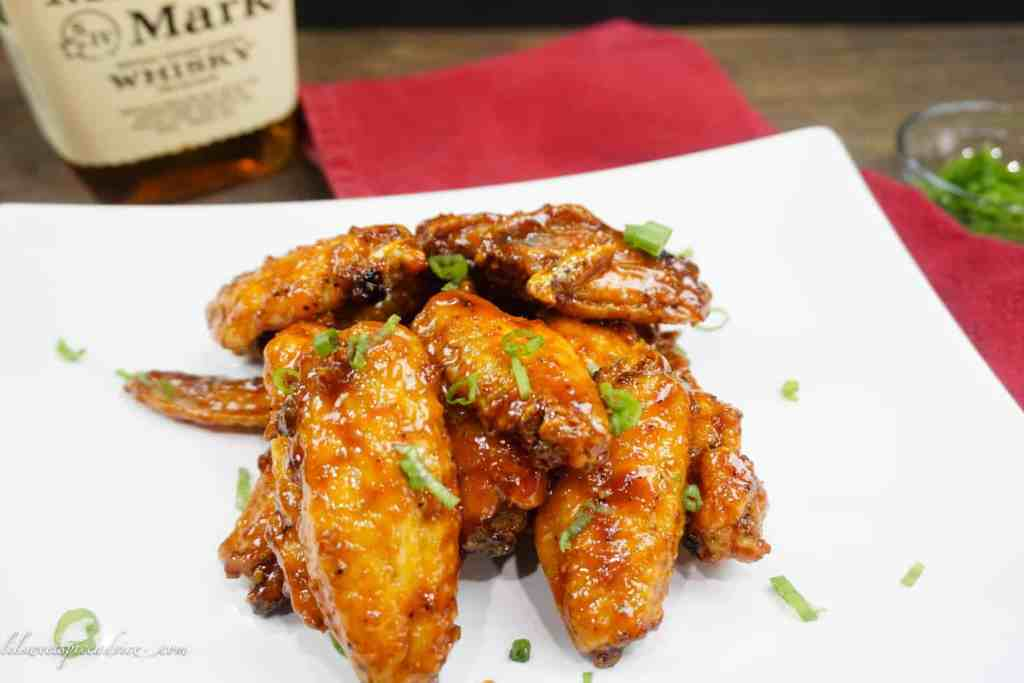 Sweet Heat Bourbon Chicken Wings-- Looking for the perfect wings for the Super Bowl? These Sweet Heat Bourbon Wings are the perfect balance between sweet and heat! They bake up perfectly crispy. -- lilsweetspiceadvice.com