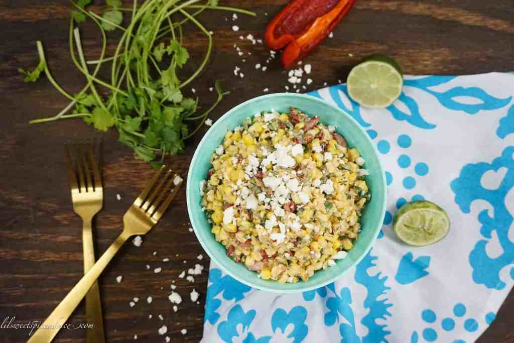 Mexican Street Corn Salad (Esquites) -- This Mexican Street Corn Salad is the perfect side dish for your BBQs and summer parties. It's creamy, a little spicy, and so smoky! -- lilsweetspiceadvice.com #mexicanstreetcorn #elotes #esquites #mexicanstreetcornsalad