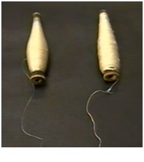 Side by side comparison of regular silk yarn on the left vs Dupioni silk yarn on the right.