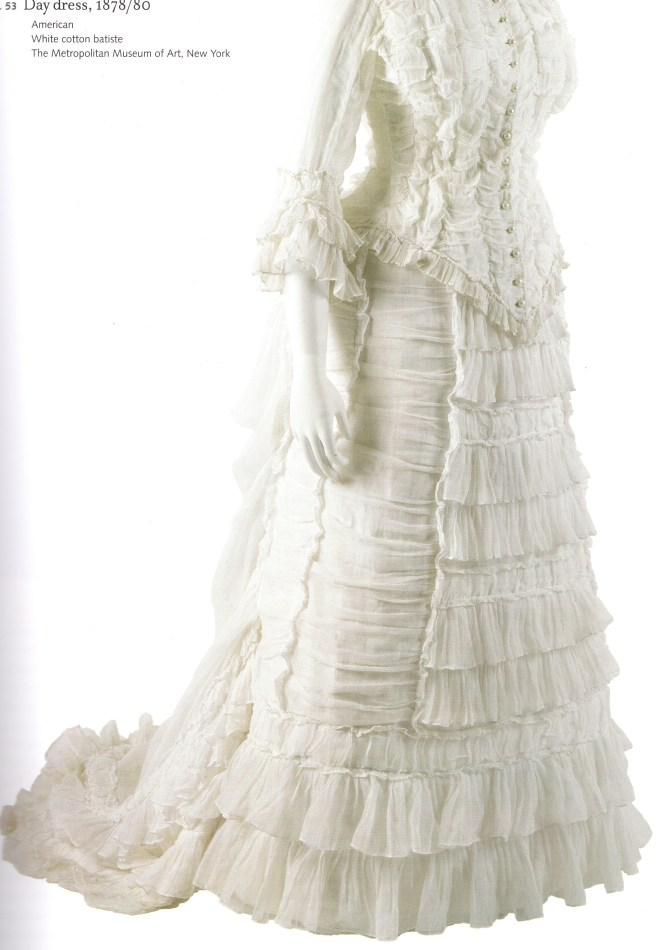 Day Dress c. 1878 - 1880, constructed of white cotton batiste; Metropolitan Museum of Art