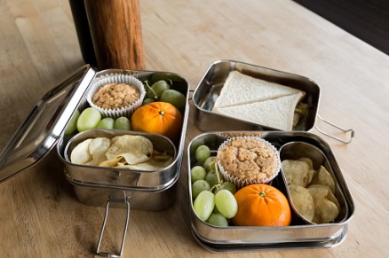 stainless steel zero waste lunch boxes with a packed lunch ready for school