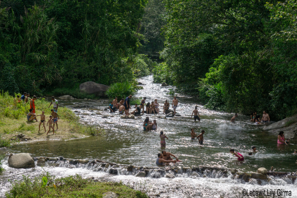 People swimming in river in Manabao, Dominican Republic.