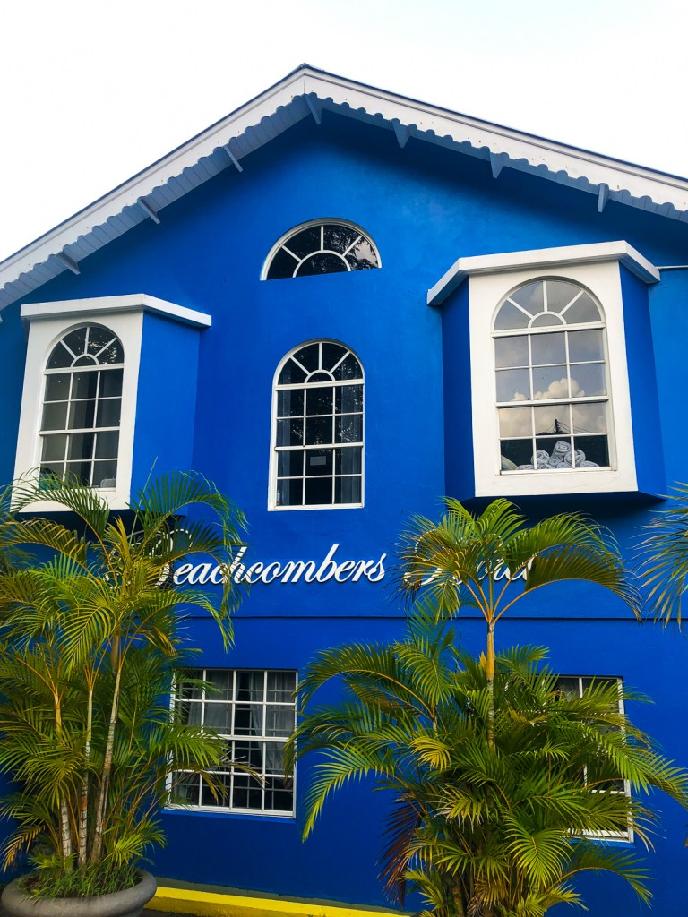 Beachcombers hotel blue building with logo