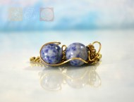 Two Sodalite Spheres Wrapped in Copper Wire