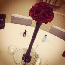 Tall red rose vase