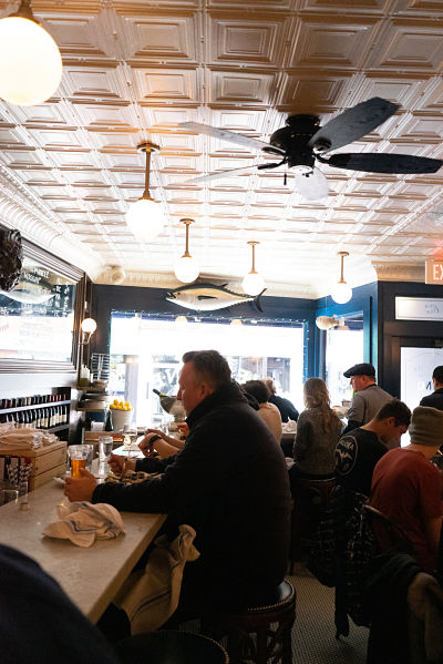 a scene at the bar at Neptune Oyster in Little Italy