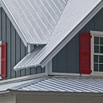 steel roofs of an old house and red window sills