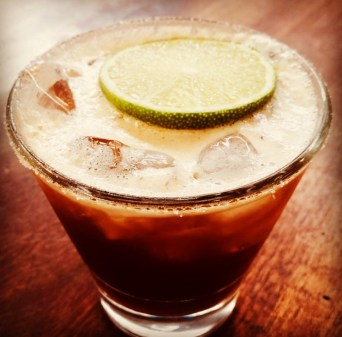 Tequila Espresso Margarita served in a short glass with a slice of lime