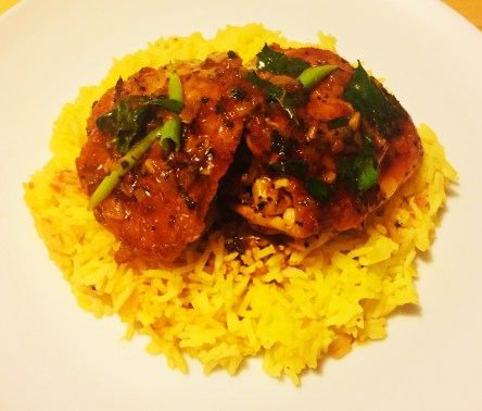Harissa Chicken Thighs with Saffron Rice on a white plate